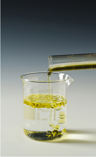 Oil being poured into water