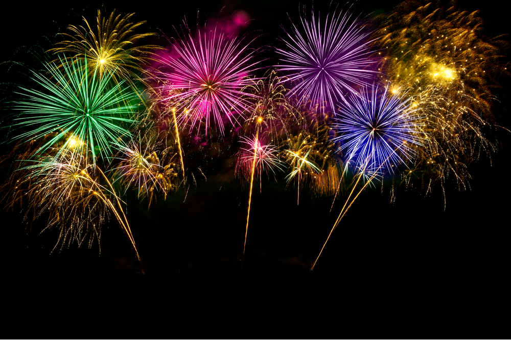 Colorful fireworks celebration and the midnight sky background