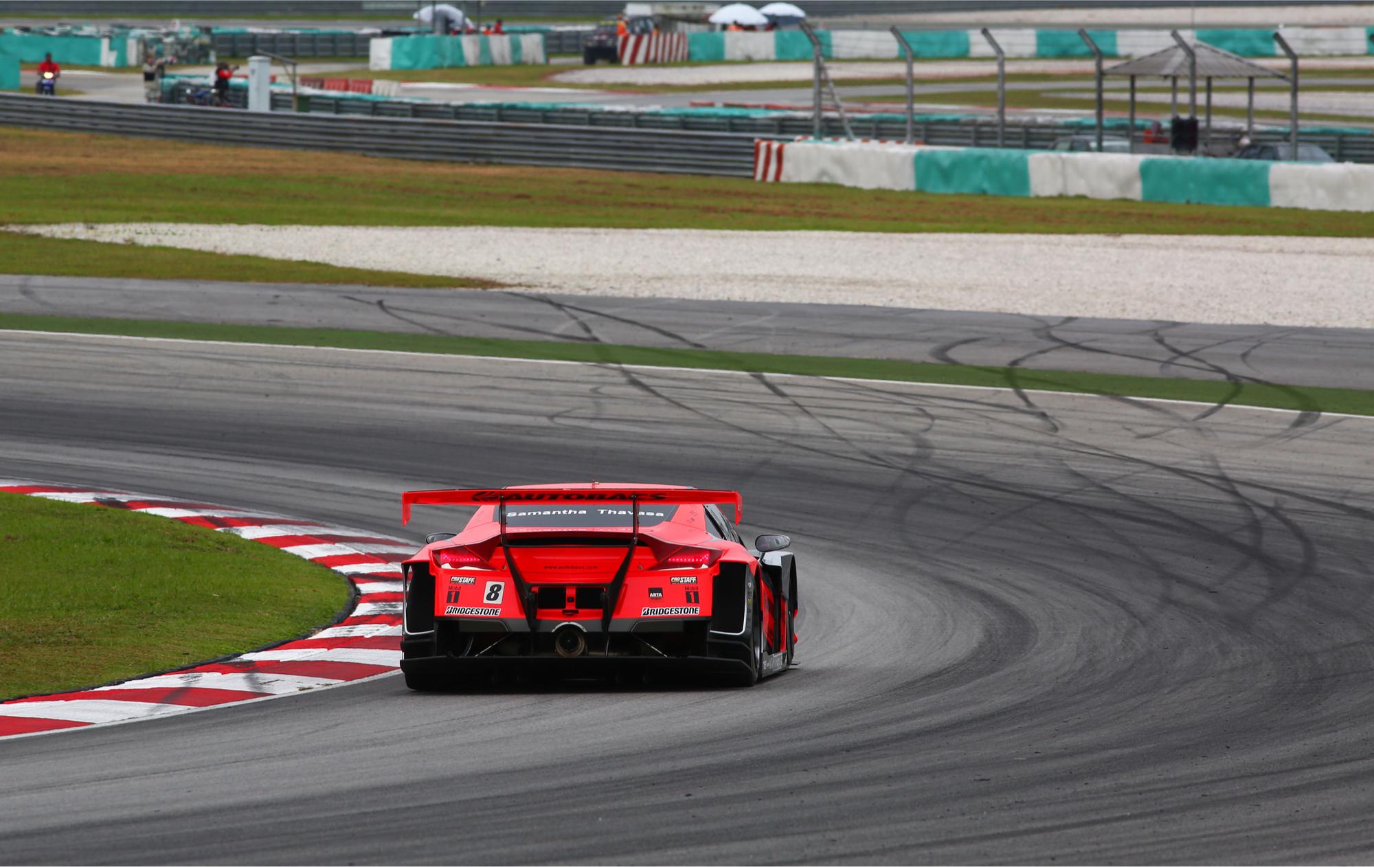 Racing car taking a tight turn