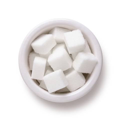 Sugar cubes in white bowl