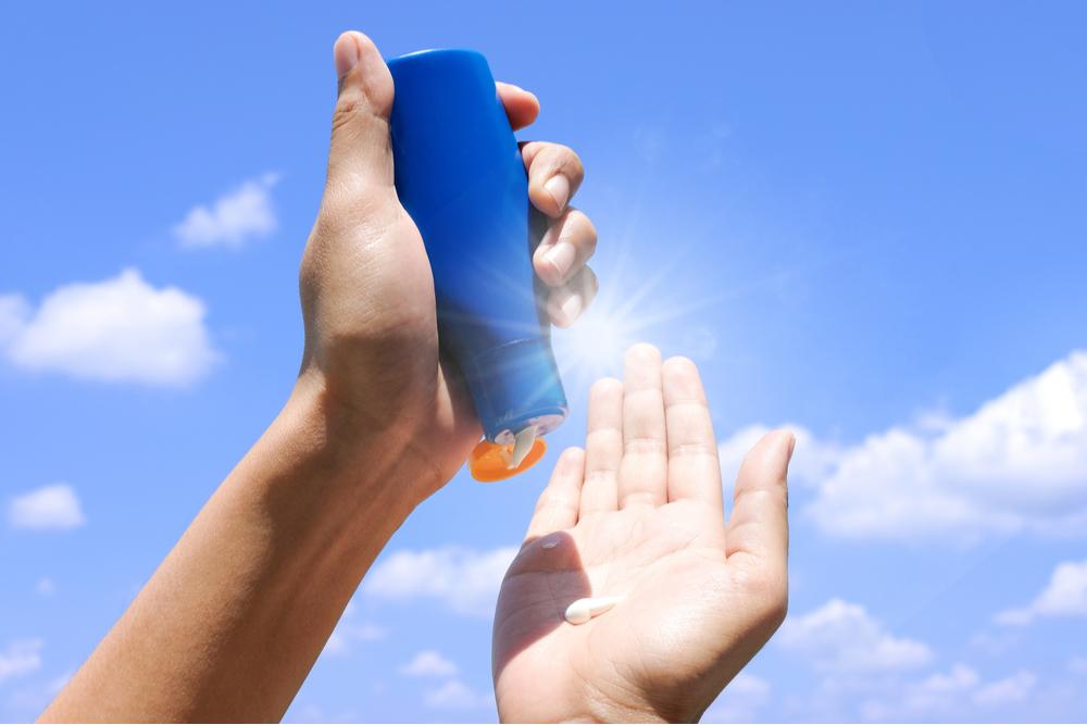 Hand holding sunscreen