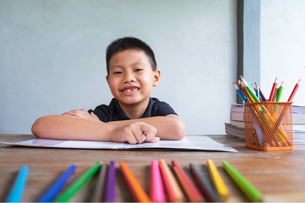 A boy sitting and studying